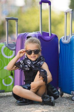 Beautiful young lady travelling with a suitcase