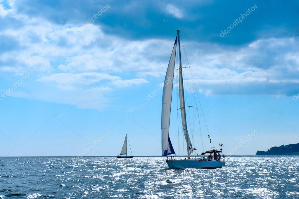 Small sailing boat in blue and calm sea — Stock Photo © ffotograff65 #34819111