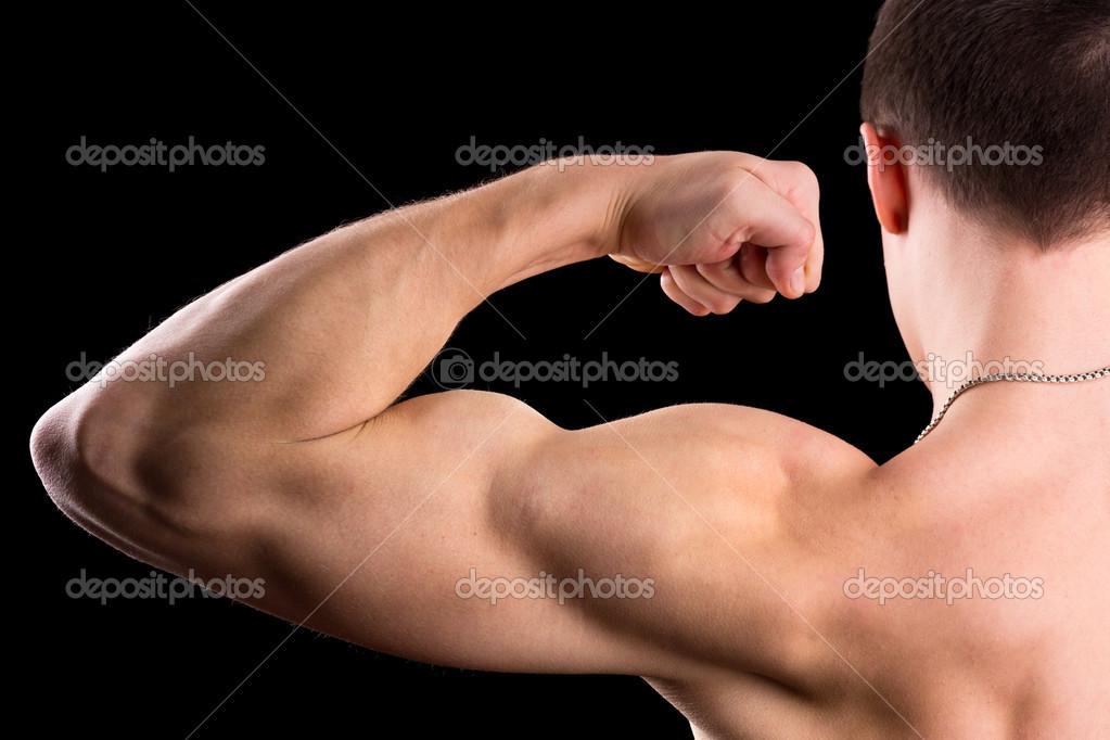brazo musculoso de hombre — Fotos de Stock © Laures #24608377