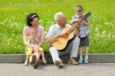 Old man playing guitar