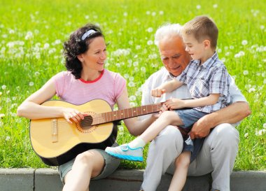 Mother playing guitar for her children