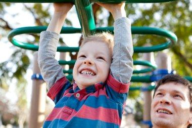 family at kids playground