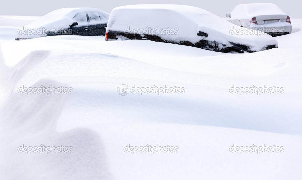Cars buried in deep snow