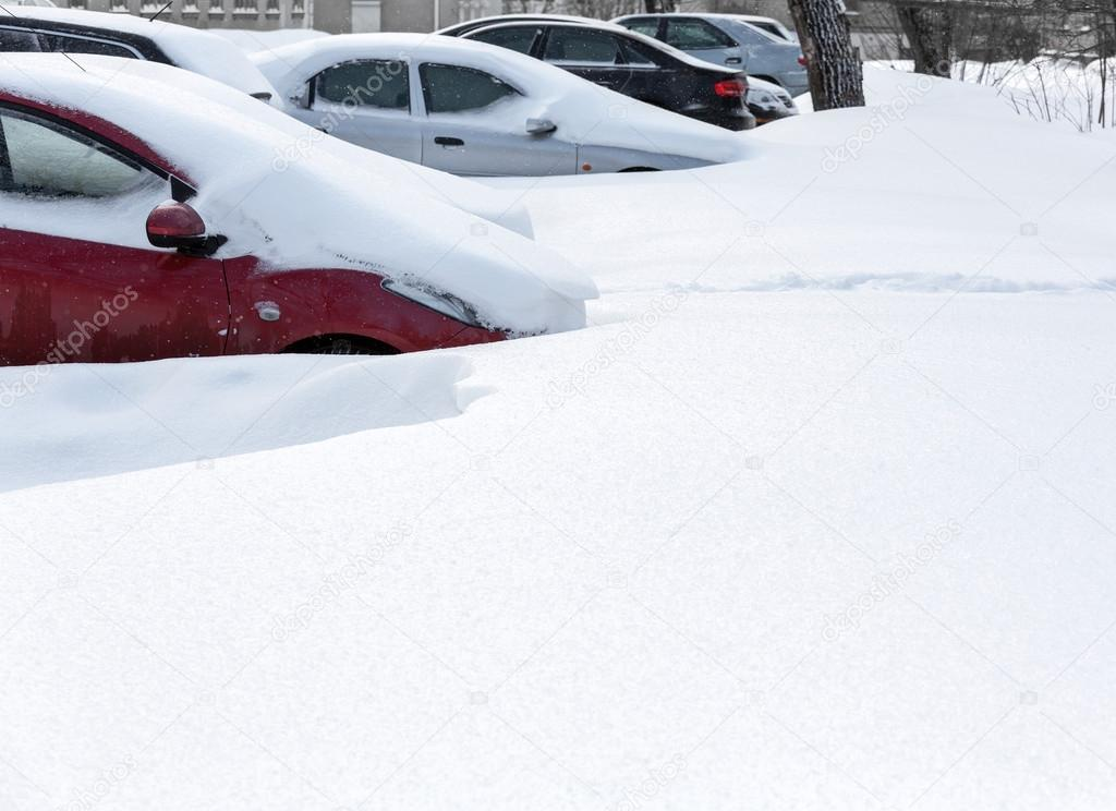 Snow covered cars in street