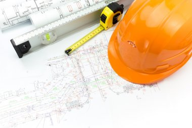 Construction plans with safety helmet