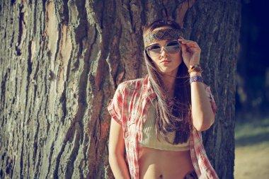 Hippie girl near tree