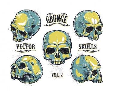 Grunge skulls vector set