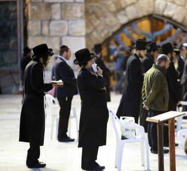 Jews being prayed at the Western Wall