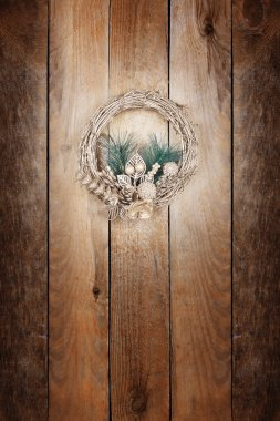 Christmas golden wreath on an old wooden door