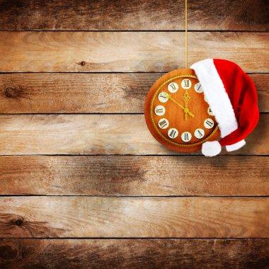 Santa Claus hat on the clock