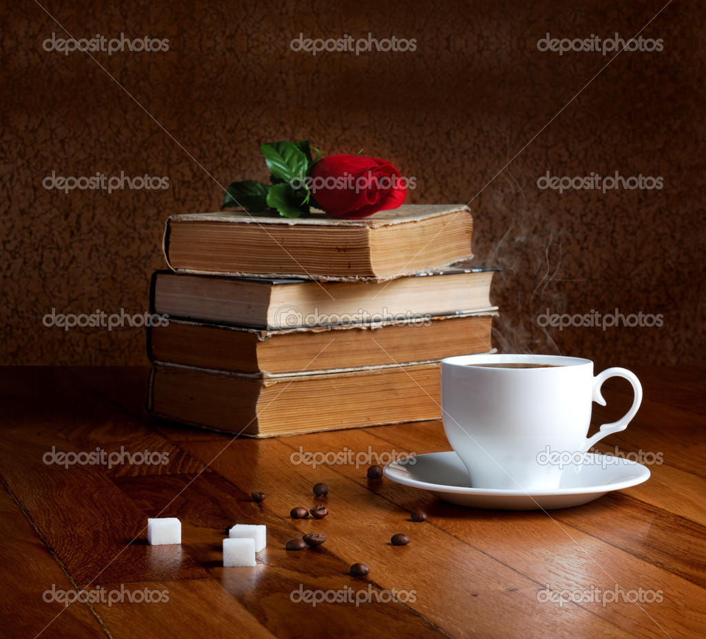 Hot cup of fresh coffee on the wooden table and stack of books hot cup of fresh coffee on the wooden table and stack of books stock photo geotapseo Gallery