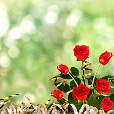 Bouquet of red roses and tulips with green leaves and ribbons on the abstract background with bokeh effect stock vector