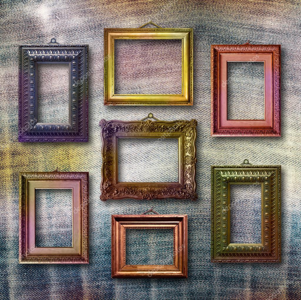 Dorado de madera marcos para fotos en fondo azul jeans - Marcos de fotos madera ...
