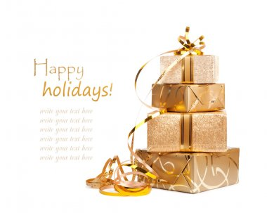 Gift boxes in gold wrapping paper
