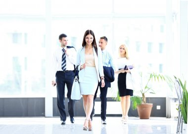 Business woman walking in office building
