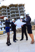 Fotografie Portrait of builders standing at building site and discussing new project