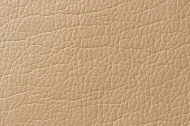 A macro shot of beige glossy artificial leather texture stock vector
