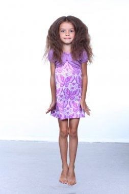 Full-length portrait of a little girl in the studio