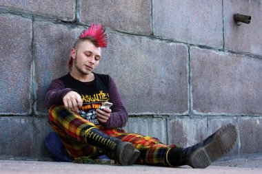 punk on the street reading sms