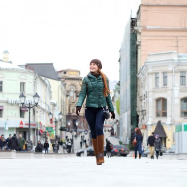 Walking woman in autumn Moscow street