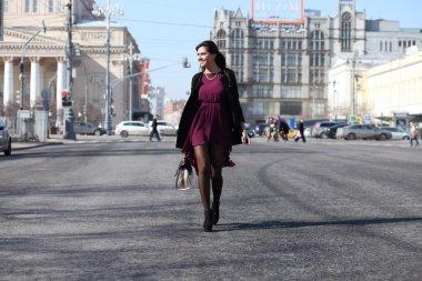 Walking woman in autumn Moscow street