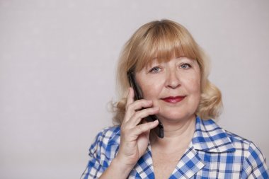 Portrait of an elderly woman calling by phone