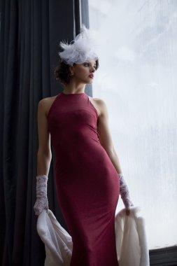 Retro styled women in club red dress