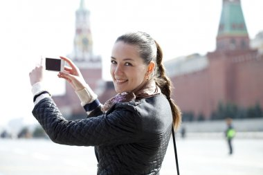 Young woman taking pictures on your phone