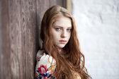 Fotografie Portrait of the beautiful red-haired girl