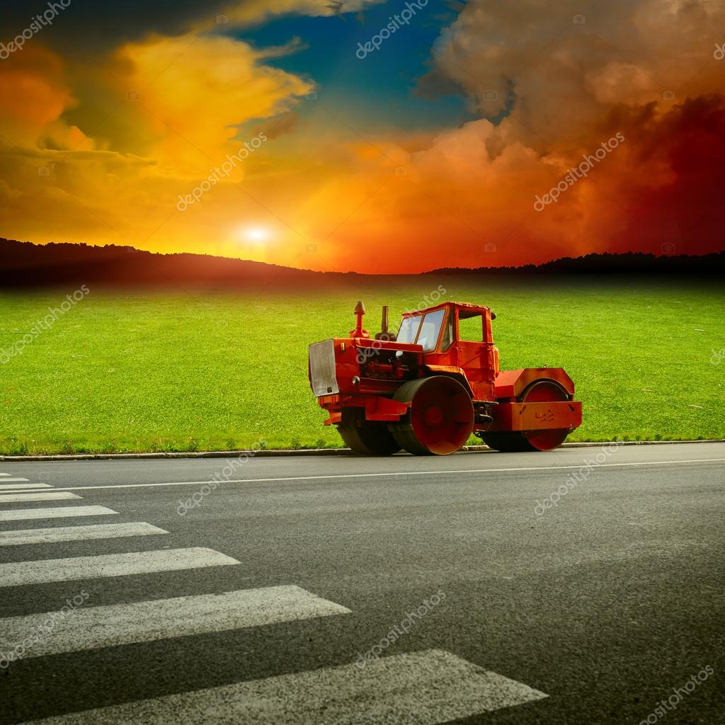 asphalt machine near by field