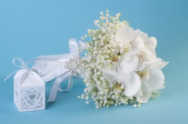 Gift box with heart and wedding bouquet