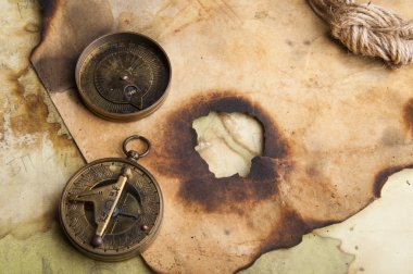 Vintage compass and burnt paper