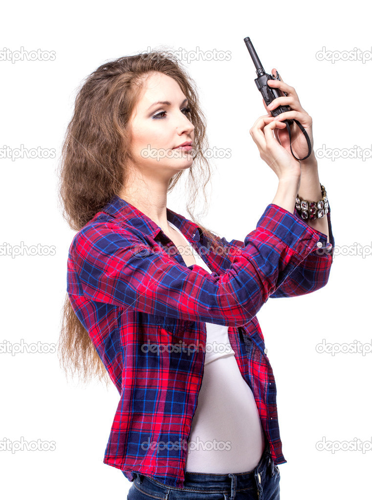 Attractive young woman in a checkered shirt with walkie talkie