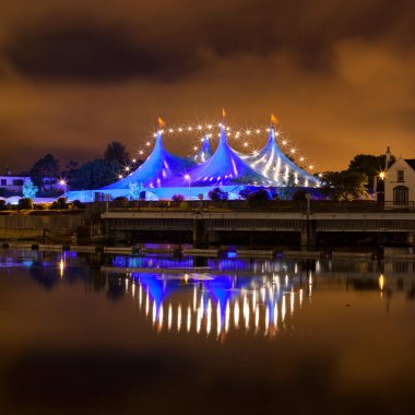 Circus style blue tent at night