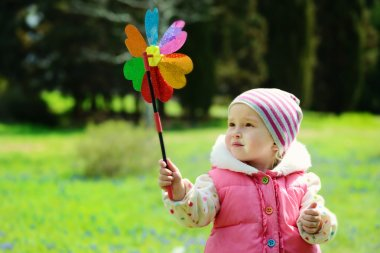 toddler girl with windmill