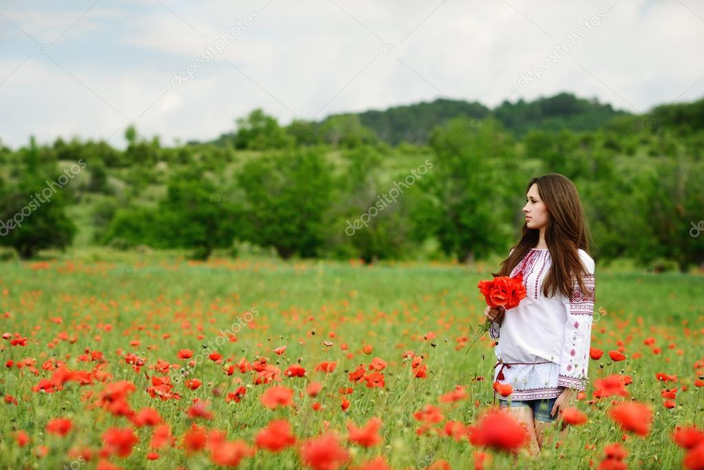 Ukrainian girl in poppy field
