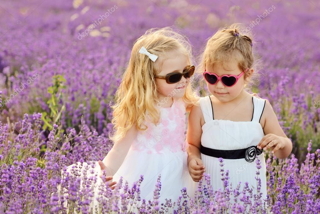 Two little girls on lavender field