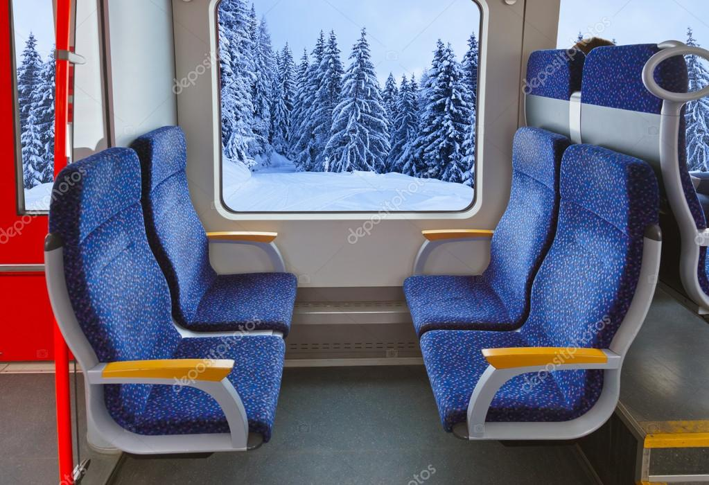 Interior of train and winter forest