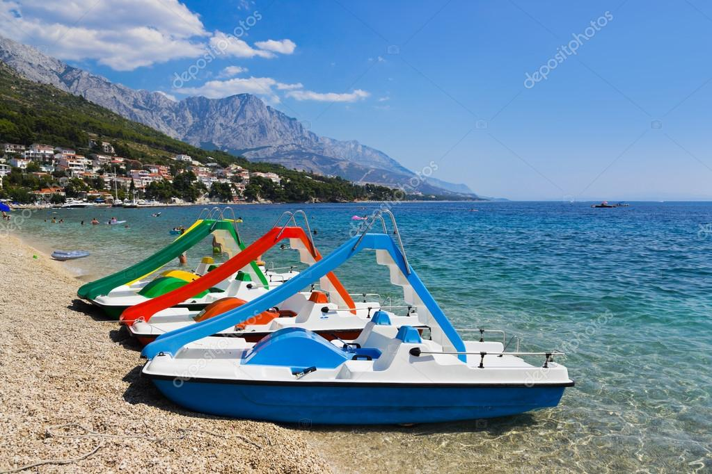 Multicolored catamaran on beach at Croatia