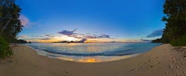 Panorama of tropical beach at sunset