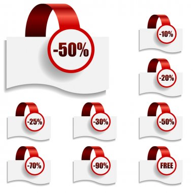 Discount tags on bent red ribbon.