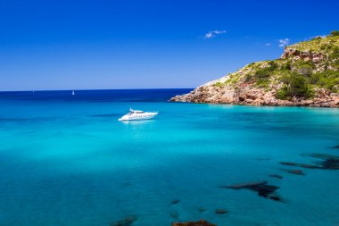 Cala de Algariens seascape in sunny day at Menorca, Spain.