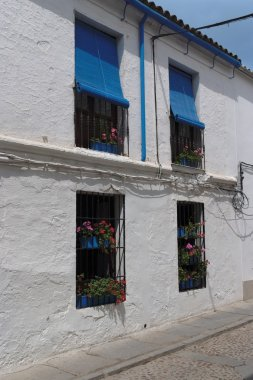 Plastered wall of two-storied Mediterranean house with four windows