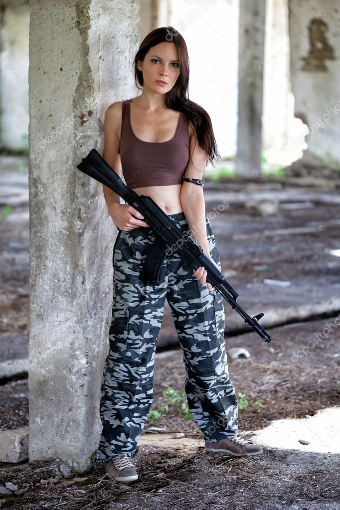 A military woman with an automatic rifle ak-74