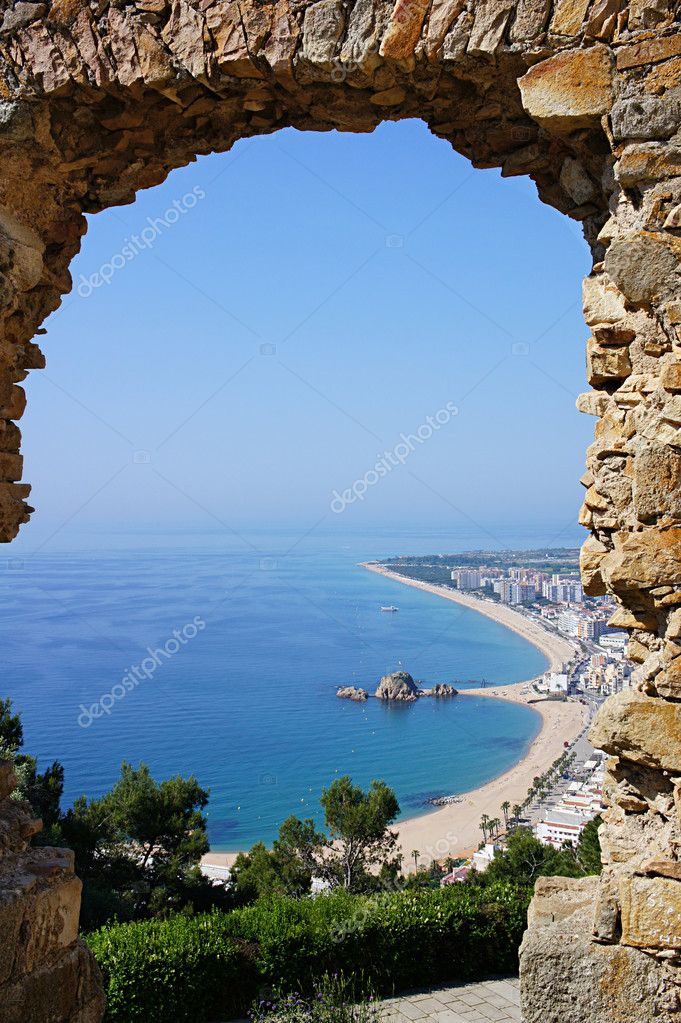 Beach Blanes view through arch. Costa Brava, Catalonia, Spain