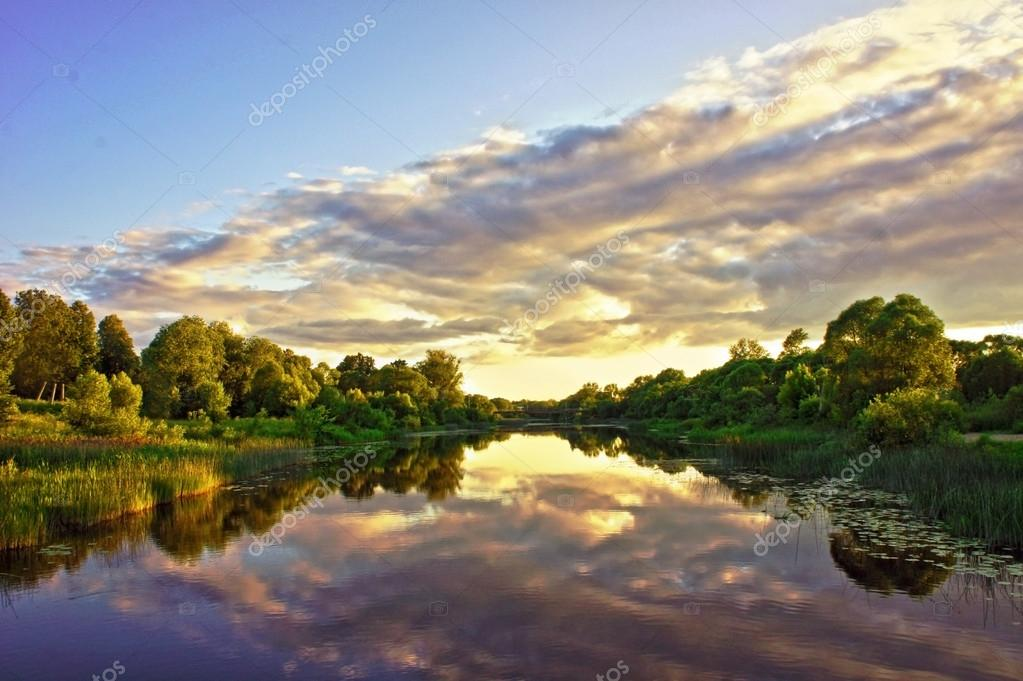 Beautiful Sunset Landscape with reflection on River Sky and Clou