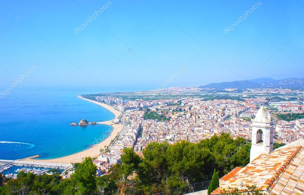 View of Spanish beach of resort town Blanes in summertime. Costa Brava, Catalonia, Spain