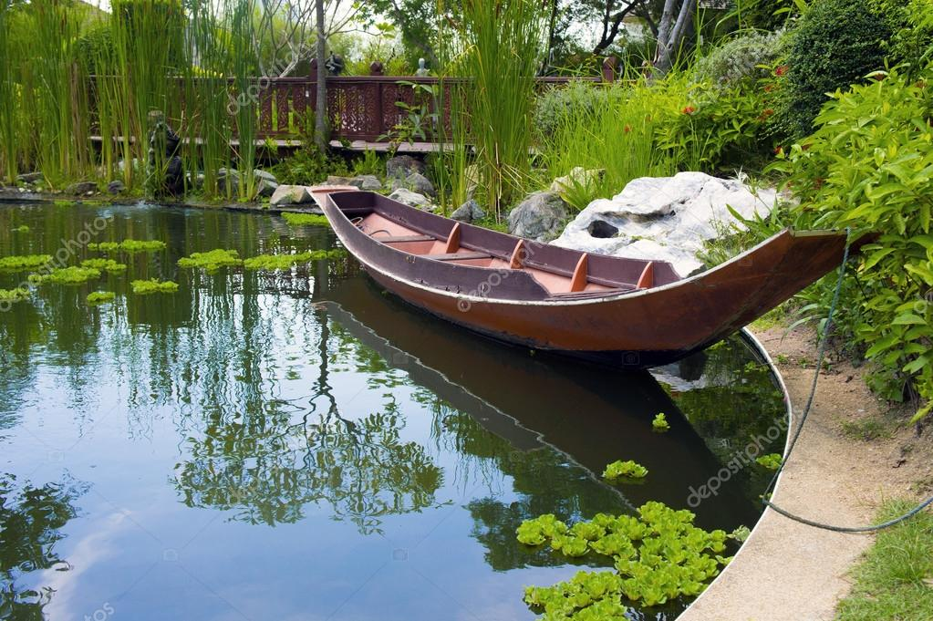 Wooden boat in pond
