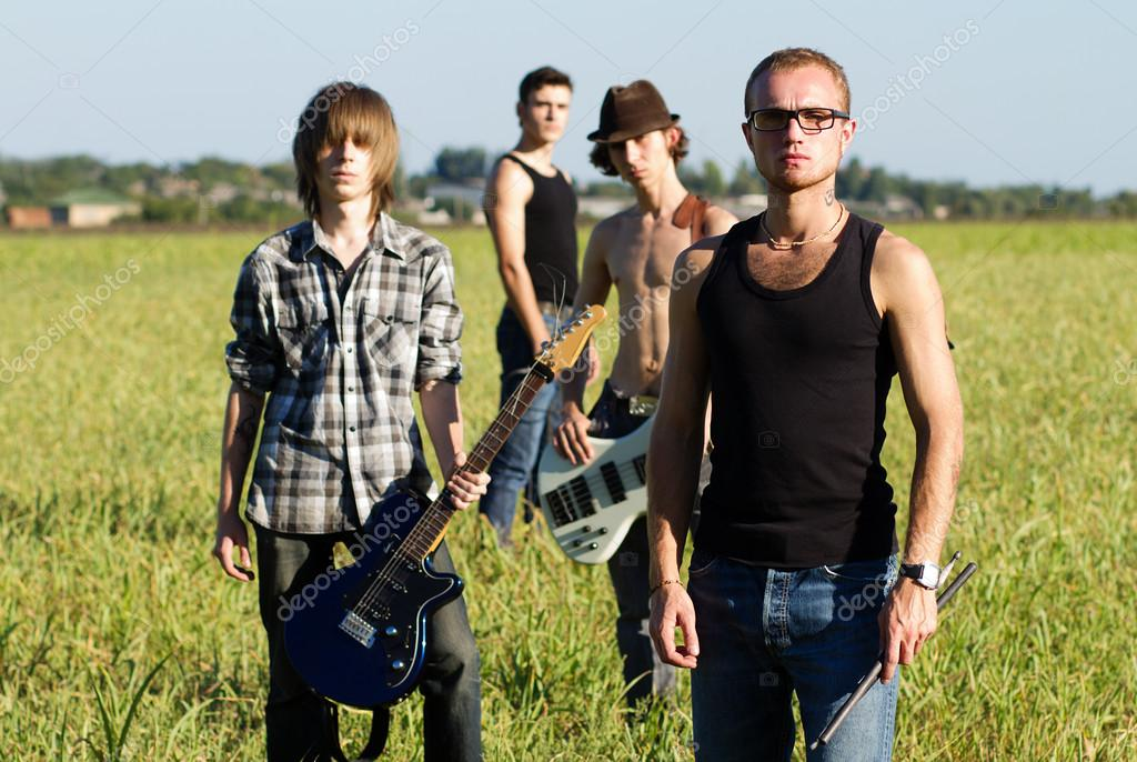 Rock band in field