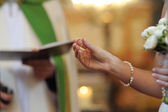 Fotografie Bride holding a wedding ring